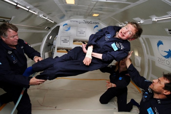 Stephen Hawking assist by Peter Diamandis (right) and astronaut Byron Lichtenberg (left), founders of the Zero G Corp, and nurse practitioner Nicola O'Brien(Credit: NASA/J. Campbell, Aero-News Network)
