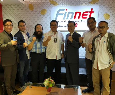 Park Kyung-yang, CEO of Harex InfoTech Inc. (third from right) took a picture with Bona L. Parapat, CEO, PT Finnet (4th from left) and executive members after signing business alliance partnership contract in Finnet headquarter in Jakarta, Indonesia.