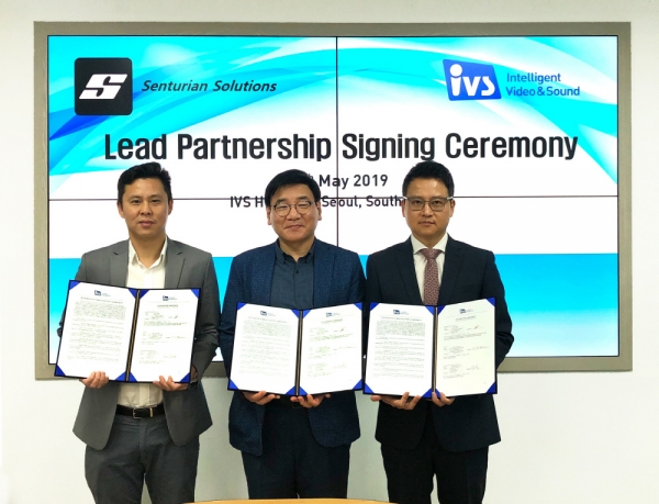 IVS CEO Bae Young-hoon (center) poses for the camera with Sean Tham (left), global sales director of Senturian, and Choi Kyung-jin, head of IVS Singapore Corp., after signing a partnership pact on May 15.