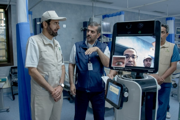 Hajj 2019 - Saudi Minister of Health Dr. Tawfiq bin Fawzan Al-Rabiah [left] inspects Robo Doctor at Mina Emergency Hospital.
