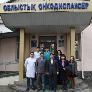 Paik Nam-sun, director of EwhaWomans University Cancer Center for Women, passes medical technology to Kazakhstan